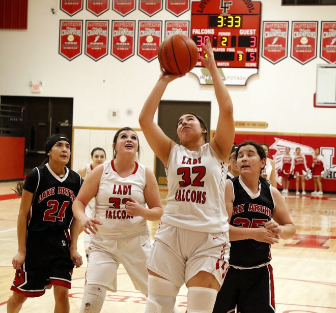 Loving's Diana Cueto goes up for a putback shot against Lake Arthur on Friday. Cueto finished with four points and 11 rebounds. Loving won, 64-11.