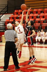 Loving point guard Tiana Rodriguez wins the opening jump ball against Lake Arthur on Jan. 10, 2020. Loving won, 64-11.
