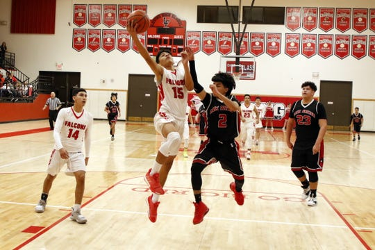 Loving's Jonathan Fuentes goes for a fastbreak layup against Lake Arthur on Jan. 10, 2020. Fuentes scored nine points for Loving in their 75-38 win.