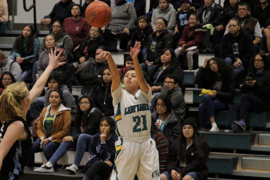 Navajo Prep's Holly Walker fires a 3-pointer against Sandia Prep during Friday's girls basketball game at the Eagles Nest in Farmington.