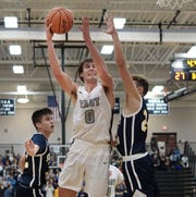 East's Nick Branton scored eight points against South Lyon in the district semifinal.