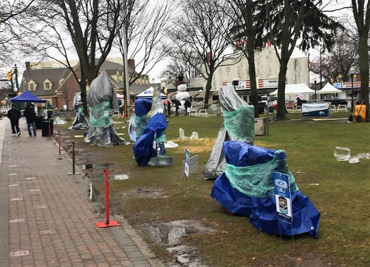 Ice sculptures were covered up due to rainy conditions during Saturday's Plymouth Ice Festival.