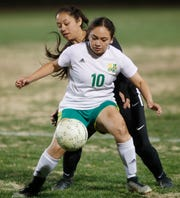 At front, Coachella Valley High School's Alexia Ortiz and Cathedral City High School's Esmeralda Ortiz The game ended with a score of 2-2 in Cathedral City.