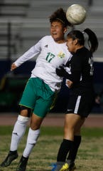 Coachella Valley High School's Angelica Leal controls the ball during her school's game against Cathedral City High School. The game ended with a score of 2-2 in Cathedral City.