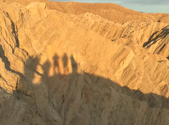 Shadows are elongated by the setting sun in the Little San Bernardino Mountains north of Indio.