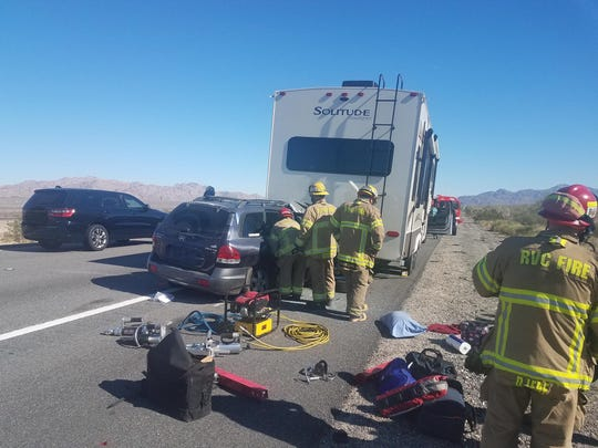 Two people were extricated from an SUV that collided with a fifth-wheel trailer Saturday afternoon on Interstate 10 east of Indio.