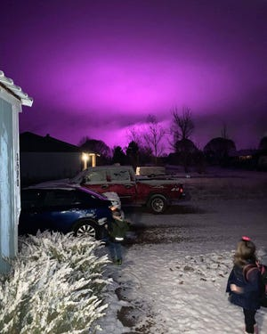 A marijuana farm causes a purple glow over snowfall in Snowflake, Arizona, on Jan. 10, 2020.