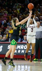 ASU's Sara Bejedi (3) shoots a three pointer against Oregon's Jaz Shelley (4) during the first half at Desert Financial Arena in Tempe, Ariz. on January 10, 2020.