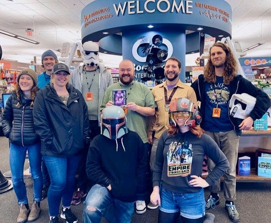 "Bookmans Flagstaff staff with their ""Star Wars"" DVD signed by Mark Hamill."