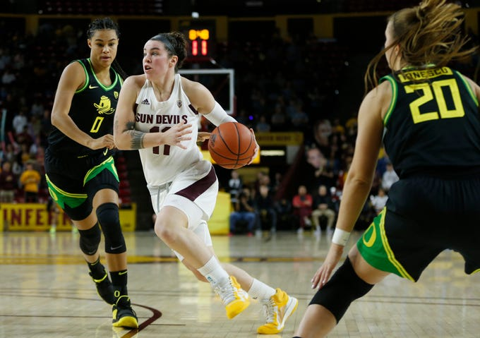 ASU's Robbi Ryan (11) drives to the basket against Oregon's Satou Sabally (0) during the second half at Desert Financial Arena in Tempe, Ariz. on January 10, 2020.