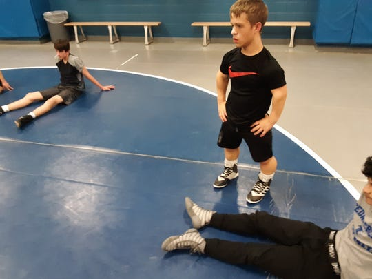 Despite being born with dwarfism, a condition that prevents him from ever growing taller than 4 feet, 8 inches, Cedar Crest junior Bailey Pennypacker is a key member of the school's wrestling team.