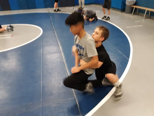 Cedar Crest wrestler Bailey Pennypacker practices a move with a teammate at a recent practice.