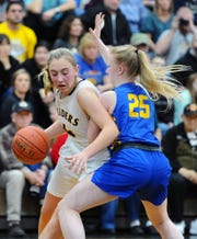 Elco's Kailey Eckhart (4) tries to get around NL's Rachel Papson (25) during the third quarter of play.