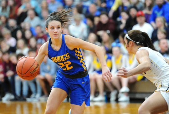Northern Lebanon's Zara Zerman (22) drives past Elco's Katelyn Rueppel (3) during the first quarter of play.