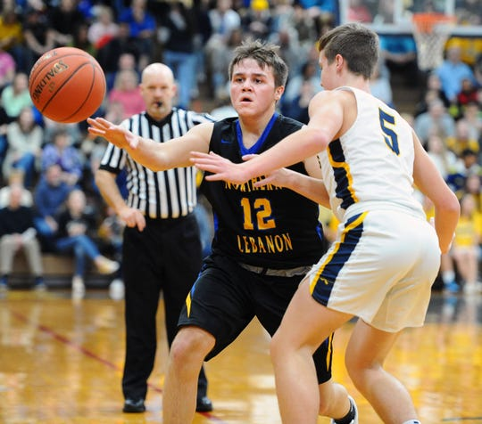 NL's Ian Herman (12) makes a pass as Elco's Ben Horst (5) is defends him during second quarter action.