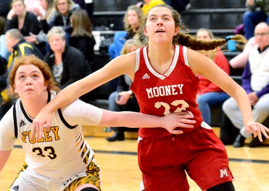 Cardinal Mooney's Reagan Wiley fights for a rebound during a Catholic League girls basketball game on Friday, Jan. 10, 2020, at Madison Heights Bishop Foley.