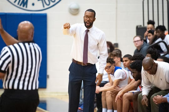 York High head coach Clovis Gallon instructs his team during the YAIAA basketball game between York High and New Oxford at William Penn Senior High School, January 10, 2020. The Bearcats defeated the Colonials 59-46.
