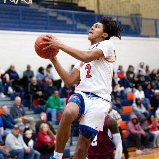 Antoine Beard (2) goes up for a layup during the YAIAA basketball game between York High and New Oxford at William Penn Senior High School, January 10, 2020. The Bearcats defeated the Colonials 59-46.