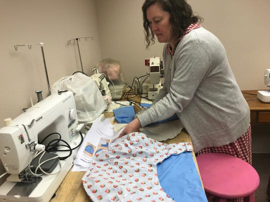 At Sew Together on Thursday, Jan. 9, Kristy Allee works on a bag that will be used to take care of an animal rescued from the fires in Australia.