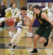 Spanish Spring's Mason Whittaker drives against Manouge's Cort Ballinger during Thursday's game at Spanish Springs.