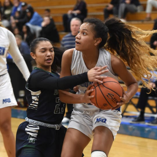 Damonte's Cyril Moore pressures McQueen's Arizana Peaua as she looks to shoot during Tuesday night's game at McQueen.