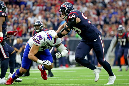 Houston Texans defensive end J.J. Watt (99) rushes the passer during the first quarter against Buffalo Bills offensive tackle Cody Ford (70) in the AFC Wild Card NFL Playoff game at NRG Stadium.