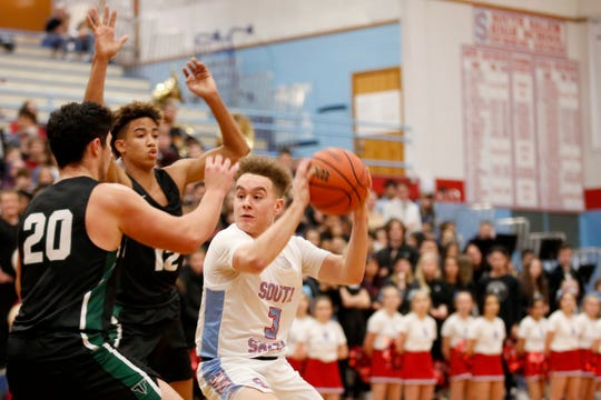 South Salem's Trey Galbraith, 3, tries to moves past Tigard's Edward Beglaryan, 20, and Malik Brown, 12, in the Tigard vs. South Salem boys basketball game at South Salem High School on Jan. 10, 2020. Tigard won the game 65-57.
