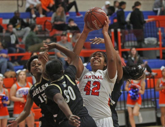 Layla Young, center, drives toward the basket for Central during a game against Abilene on Friday, Jan. 10, 2020.