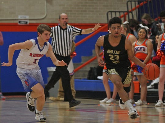 Dj Modest, right, dribbles the ball down the court for Abilene during a game against Central in San Angelo on Friday, Jan. 10, 2020.