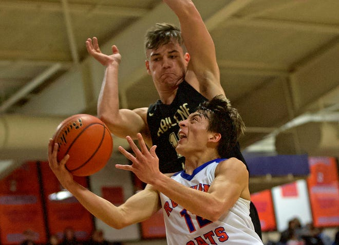 Tristan Lopez, lower center, drives toward the basket for Central during a game against Abilene in San Angelo on Friday, Jan. 10, 2020.