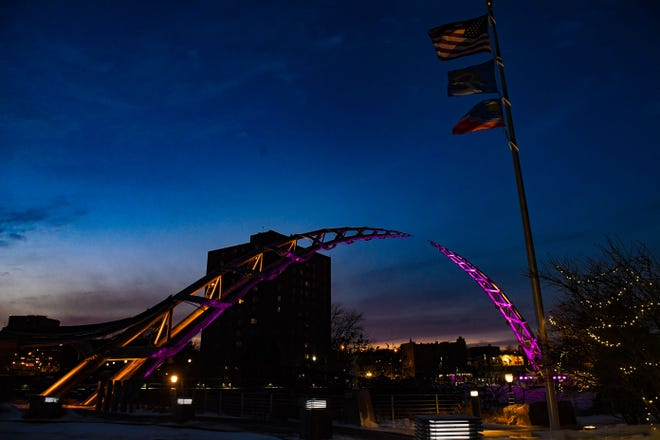 The Arc of Dreams is lit in purple and gold for the Minnesota Vikings game this weekend on Friday, Jan. 10, in Sioux Falls.