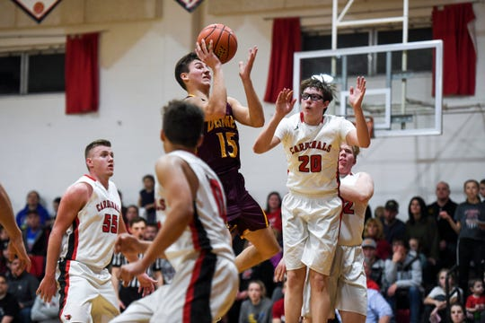 De Smet's Kalen Garry (15) goes up for a shot against Dell Rapids St. Mary during the game on Friday, Jan. 10, 2020 at the Dell Rapids St. Mary High School.