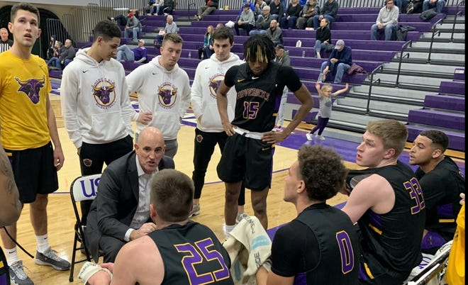 Minnesota State coach Matt Margenthaler talks to his players during a timeout in the first half of Friday's game against USF at the Stewart Center.