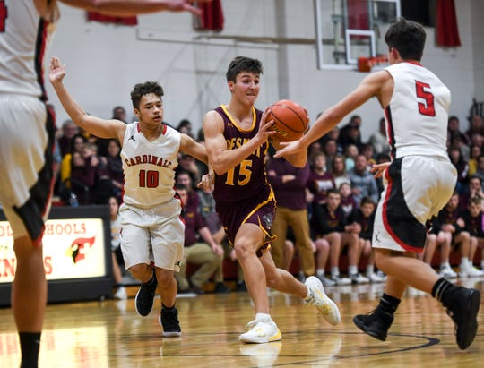 De Smet's Kalen Garry (15) runs the ball down the court during the game against Dell Rapids St. Mary on Friday, Jan. 10, 2020 at the Dell Rapids St. Mary High School.