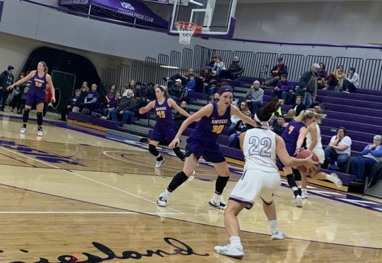USF's Mariah Szymanski looks to get around MSU-Mankato's Taylor Drost Friday night in their game at the Stewart Center.