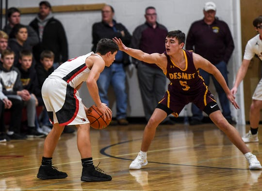 De Smet's Rett Osthus (5) guards Dell Rapids St. Mary's Connor Libis (5) during the game on Friday, Jan. 10, 2020 at Dell Rapids St. Mary High School.