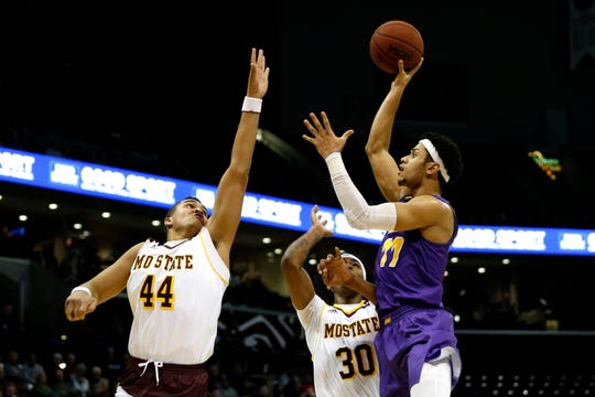 Northern Iowa Panthers guard Trae Berhow (11) shoots a field goal over Missouri State Bears forward Gaige Prim (44) during a game at JQH Arena on Saturday.