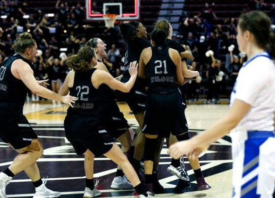 The Lady Bears celebrate after guard Sydney Manning's buzzer-beater shot gave them the win over Drake on Friday at JQH Arena.