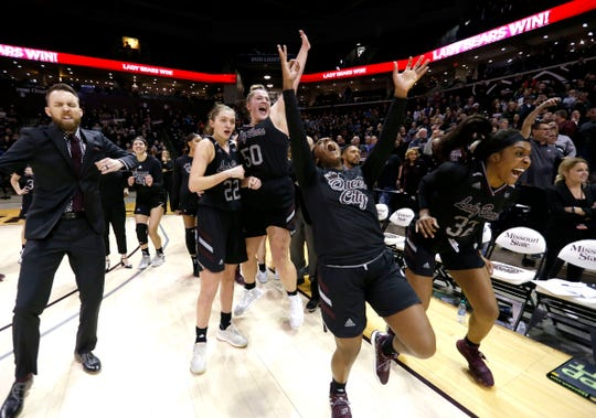 The Lady Bears celebrate after Friday night's win over Drake at JQH Arena.
