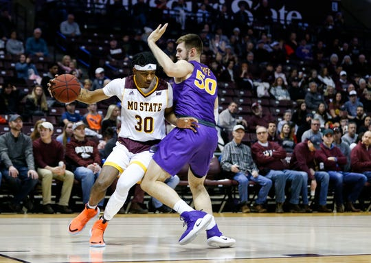 Missouri State Bears forward Tulio Da Silva (30) drives to the lane around Northern Iowa Panthers forward Austin Phyfe (50) during a game at JQH Arena in Springfield, Mo. on Saturday, Jan. 11, 2020.