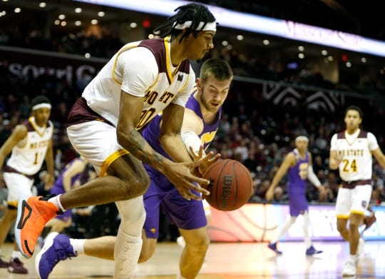 Missouri State Bears forward Tulio Da Silva (30) attempts to save an out-of-bounce ball during a game against the Northern Iowa Panthers at JQH Arena in Springfield, Mo. on Saturday, Jan. 11, 2020.