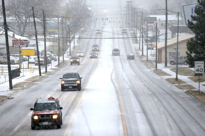 Snow covering Kearney Street in Springfield, Mo., on Saturday, Jan 11, 2020.