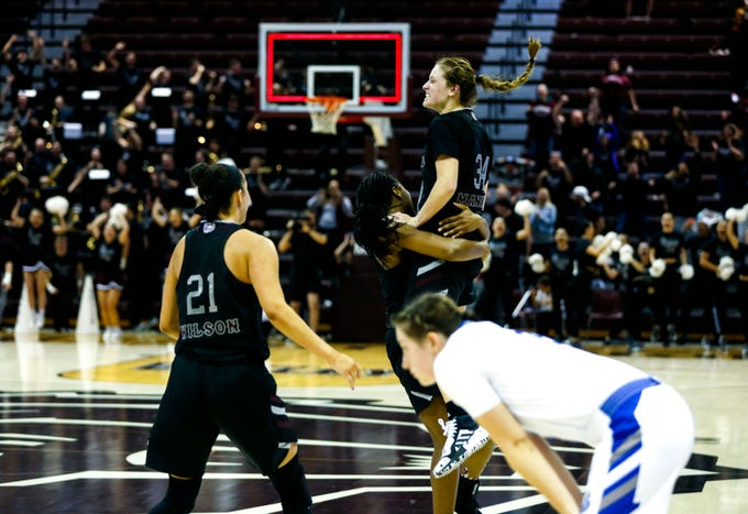 Missouri State Lady Bear Sydney Manning is swarmed by teammates after hitting a game winning three-pointer at the buzzer on the Drake Bulldogs at JQH Arena in Springfield, Mo. on Friday, Jan. 10, 2020.