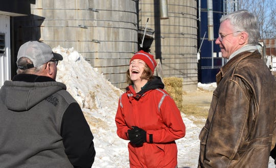 U.S. Sen. Tina Smith laughs while speaking with farmer Steve Anderson (left) and Minnesota Farmers Union President Gary Wertish Saturday, Jan. 11, 2020, in Foley.