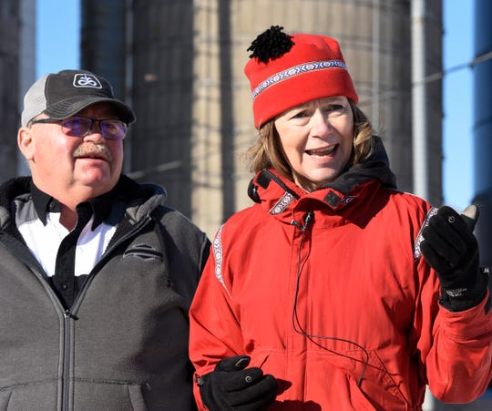 U.S. Sen. Tina Smith speaks to the media at Steve Anderson's (left) farm Saturday, Jan. 11, 2020, in Foley.
