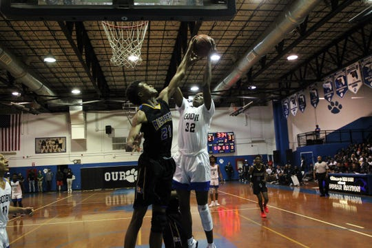 Godby senior center Autavian Gibson tries to get an offensive rebound while Rickards junior Khamari McGriff goes for the ball as Rickards' boys basketball team beat Godby 83-65 on Jan. 10, 2020.