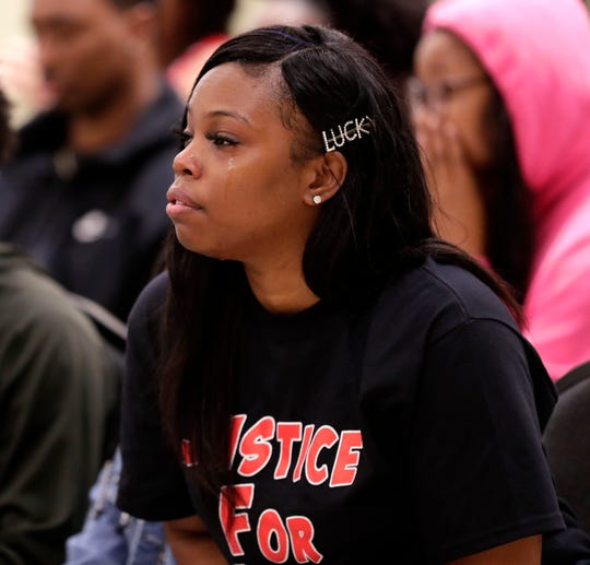 Tears roll down Jamesha Douglas' face during a vigil for her younger brother Jamee Johnson. Johnson was killed by a police officer in Jacksonville during a traffic stop in December 2019.