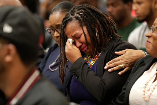 Professor Kalena Green from the FAMU school of business and industry wipes away tear with a tissue as Sharon Robinson consoles her during a vigil for FAMU student Jamee Johnson. Johnson was killed by a police officer in Jacksonville during a traffic stop in December 2019.