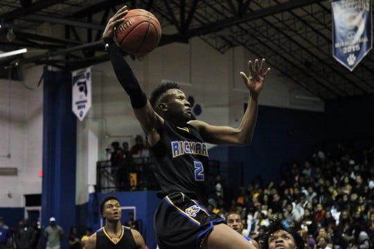 Rickards senior forward Myles Smith soars through the air for a dunk as Rickards' boys basketball team beat Godby 83-65 on Jan. 10, 2020.