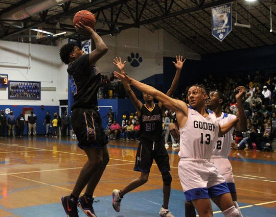 Rickards senior guard Zackary White shoots a jumper as Rickards' boys basketball team beat Godby 83-65 on Jan. 10, 2020.
